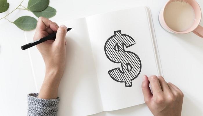 お金のマークをノートに書く